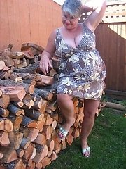 Seductive Girdlegoddess is waiting for you out by the wood pile Wouldnt you just love to bend me over that stack of wood and fuck me hard MMMmmmm soun