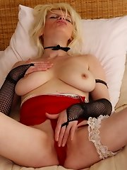 Naughty blonde housewife teasing her wet pussy