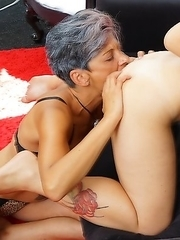 Old and young lesbian couple make out on the couch