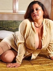 Mega big breasted Latina housewife getting ready to tease and please